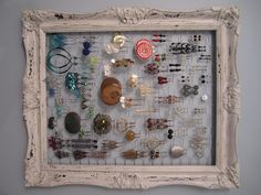 old frame + paint + chicken wire=  earring storage