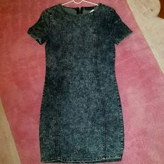 Denim dresse. Never been worn. Denim short dresse. Tight to the body showing all ur curves. Sipper back as shown very sexy. Dresses Mini