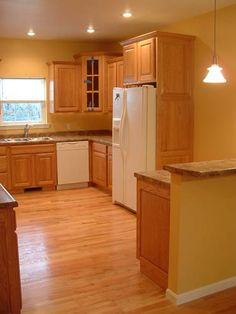 Kitchen Flooring with Oak Cabinets | Kitchen w/ Oak Cabinets and Floor (Bailey Rd.) | Britton Development