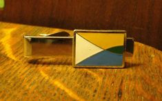 Hardly if ever 58 inches square Gold toned colour is on the paler side Mid century CUFFLINKS have raised triangle design worn.