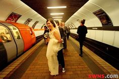 Travelling in Style! These newlyweds got to their reception with their guests on  Glasgow's famous subway & got some amazing wedding photos! http://swns.com/news/the-tunnel-of-love-newlyweds-stun-commuters-by-taking-the-subway-to-their-reception-including-their-40-guests-23757/