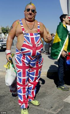 Flying the flag: This fan shows his support as he makes his way to England's last match of...