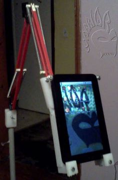 Upcycle a broken Ledu lamp into a zero-gravity stand for a tablet or ereader -- Floor stand with Sugru use