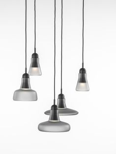 White interior - Brokis lights - Grey Mat Shadows are hanging lights. The designer Lucie Koldova and Dan Yeffet.