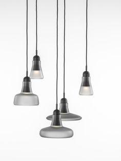 White interior - Brokis lights - Grey Mat Shadows are hanging lights. The designer Lucie Koldova and Dan Yeffet.