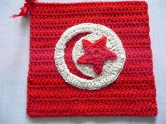 Flag of Tunisia from Karla B. To learn more about our organization go to www.knit-a-square.com To meet our members and see more of our knitting and crochet go to http://forum.knit-a-square.com/