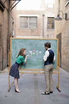 mobile chalkboard prop! makes for a fun narrative for an e-sesh/save-the-date. other ideas to draw on chalkboard: thought bubbles with lyrics; a pair of earbuds to share/pose under; a door to walk through.