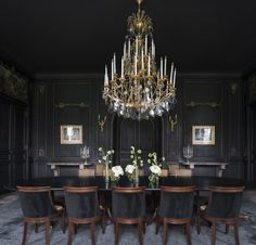 At the invitation-only L'Hôtel du Marc (located in the Champagne capital of Reims, France), interior designer Bruno Moinard crafted a dark, moody dining space by combining a Matthieu Lustrie chandelier with the room's original, 1840 wall sconces.