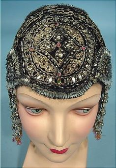 "c. 1923/1924 RARE Deco Flapper Beaded Cloche or Flapper Headpiece. Complete with long dangle beaded fringe at both sides!! Awesome!! Certainly has that Egyptian feel that was all the rage after King Tut's tomb was discovered in November, 1922 - AND this is still a large size which means it was used by a girl who hadn't yet cut off her hair to the fashionable, but still controversial short bob... so she had lots of ""Edwardian hair"" to pin up to fit under this."
