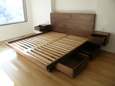 Platform Bed with Drawers - Platform bed in solid walnut with 4 large sub-drawers and wall-mounted sidetables
