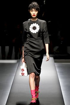 And love this Prada too, the structure of the dress and the colorful footwear (Prada Spring 2013)
