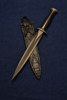 Nathan Carothers custom machined dagger with Dave Seward sheath. Nathan actually machined this knife, rather than forged or ground. The man's got amazing skills. One of the coolest daggers I've seen in recent years.