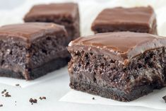 The Ultimate Triple Layer, Fudgy Brownies! Dense, fudgy brownies with an Oreo cookie base and a satiny, chocolate fudge glaze. Irresistably decadent!