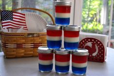 Patriotic Jello Jars....add some blue food coloring to make the blue bluer, chill, next is a layer of white chocolate pudding, then gently add red jello...