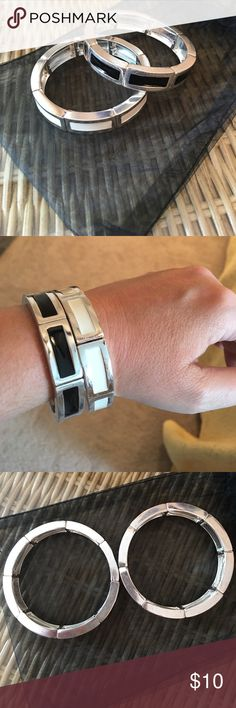 WHBM set of two elastic bracelets Black and white on silver tone, Good condition, sides of both bracelets have a little discoloration and wear but can't be seen while wearing, pictures provided, stretchy elastic. No trades. White House Black Market Jewelry Bracelets