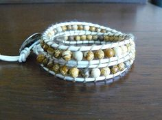 This Wrap Bracelet features 4mm Picture Jasper Gemstones strung around 1.5mm White Leather Cord and one piece of thread is doubled for extra durability. Stylish sliver button for the finishing touch!    Great everyday effortless look and can be worn alone or can be worn other wrap bracelets. Meant to be worn comfortably, not to snug or too loose.    This wrap is 17 inches long and the two closures are at 15 & 16 inches, fits wrist size 6-7 inch wrist.    I hand make every bracelet myself…