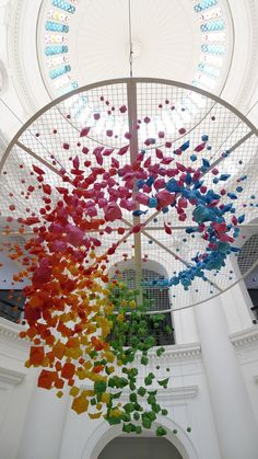 Giant, rainbow hanging installation of 1,000 origami spheres, fish and boats | Creative Boom