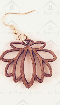 These beautiful laser cut lotus flower earrings have been designed by my wife and I.  They would make a  truly original and unique gift item.  They are super light to wear.  The earring are gold plated and the flower is cut from sustainable poplar wood with a medium stain finish. J&J