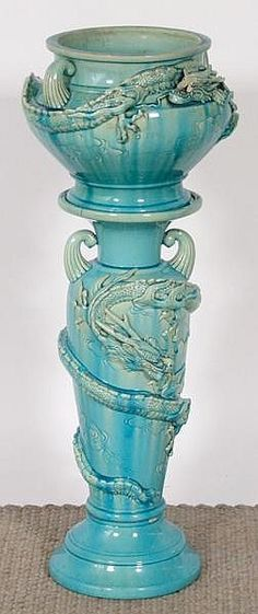 JARDINIERE AND PEDESTAL. Asian dragon decorated art pottery jardiniere and pedestal, shaded turquoise glaze.