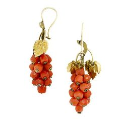 Victorian Coral Grape Cluster Drop Earrings:: featuring a cluster of red coral beads with gold vine leaf tops, fashioned in 14k. Circa 1850.