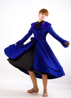 I found a winter coat I love.  I just love the idea of twirling around in this.  I want it in gray or winter white.     Dance of Love  blue woolen long coat by xiaolizi on Etsy, $129.00
