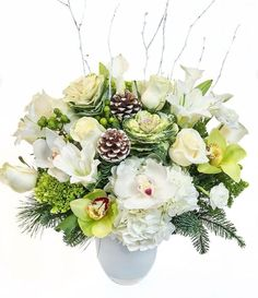 Our 'Winter in Wonderland' exclusive design features a lovely collection of winter flowers. hydrangeas, orchids, roses, lilies & more with winter accents. Designed in a beautiful white vase. Boston Florist, Local Florist, Winter Flowers, Spring Flowers, Flower Arrangements Simple, Central Square, Cymbidium Orchids, Winter Wonderland Wedding, Festival Lights