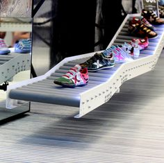 Shoes Displayed on Conveyor Belts - Commercial Interior Design News Commercial Architecture, Commercial Interior Design, Commercial Interiors, Belt Display, Shoe Display, Display Ideas, Shoe Store Design, Shoe Shop, Design Shop