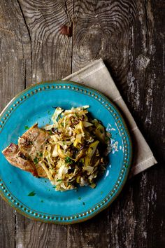 Oven Baked Pork Chops with Apples and Cabbage. This easy sheet pan dinner is amazing! The pork chops stay moist and juicy and the apples and cabbage are sweet and crisp tender! This Pork Chops with Apple Cabbage Slaw is an easy sheet pan dinner! Pan Pork Chops, Apple Pork Chops, Baked Pork Chops, Pork Roast, Healthy Pork Recipes, Meat Recipes, Apple Recipes, Delicious Recipes, Best Pork Recipe