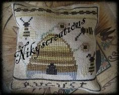 August Bee is the title of this cross stitch pattern from Niky's Creations that is stitched with DMC threads.