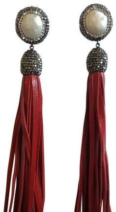 Striking bohemian pearl and druzy earrings with long leather suede tassels. 5 inches of pure luxe.
