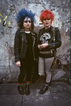 1982 SoHo punks, London, photo by Derek Ridgers -  punks on the street, leather jackets, blue hair, red hair, studs