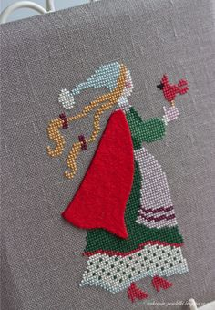 Pretty Winter girl in cross stitch