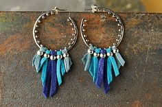 These effortless earrings are the perfect pop of color for winter! Make your own with suppies at http://www.ninadesigns.com/jewelry_design_ideas/leather_fringe_earrings.html