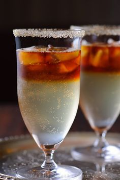 """The forecast tonight calls for a Dark and Stormy cocktail – a beautifully layered drink with the sharp bite of Ginger Beer, tempered with a moody wash of tropical Dark Rum.  As the unofficial drink of Bermuda, this cocktail's name is actually trademarked by Gosling's and must be made with Gosling's Black Seal Rum to sport the """"Dark 'N Stormy"""" name."""