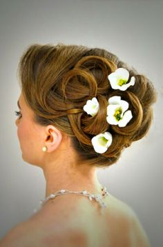 Glamorous bridal hair using real hair.  Styled by Roxy Farrier info@roxyfarrier.co.uk