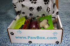 Paw Box - monthly dog product sampling service. i need to try this.