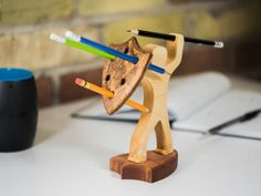 *** NEW - Two new pencil holder base styles now available *** The pen is mightier than the sword. Wait till you see what a pencil can do! No wonder it takes a true warrior to handle it. This stylish pencil holder in the shape of a brave warrior is h Kids Woodworking Projects, Woodworking Furniture, Woodworking Tips, Wood Projects, Popular Woodworking, Unique Woodworking, Youtube Woodworking, Woodworking Patterns, Furniture Projects