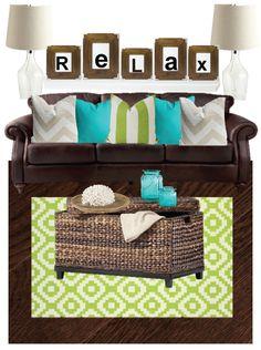 Birch Grove Interiors, Coastal living room, aqua and green home decor, green rug, rattan ottoman, chevron pillows, leather couch, clear glass lamps, pottery barn style, beach decor