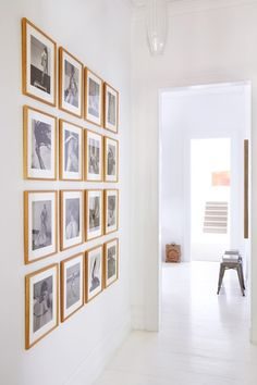 For a more modern look for a large wall, use a strict grid pattern with pieces that are all the same size and framed the same way.