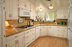 Beautiful White Kitchen Cabinets Brown Varnish Wood Full Area Floor Stainless Steel Modern Range Hood White Stained Wooden Kitchen Island White Stained Wood Dining Table White Tile Backsplash : Home Design and Interior Decorating ~ Shaidee Corner Sink Kitchen, Kitchen Sink Design, White Kitchen Cabinets, Wooden Kitchen, Kitchen Tiles, Home Decor Kitchen, New Kitchen, Kitchen White, Cream Cabinets
