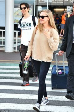 Amanda Seyfried and her birthday boy beau Justin Long arrived in Tokyo to promote Amanda's new movie