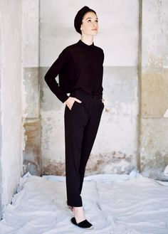 The turtle neck tucked in to slacks in black, chic!