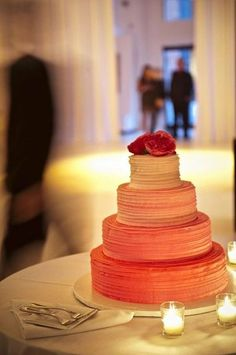 Coral wedding cake; ombré by tier instead of bottom to top.  Great design.