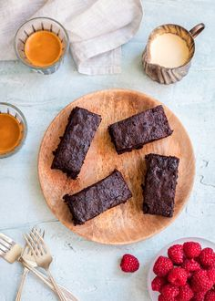 Soft and fudgy this chocolate brownie is perfect to serve as afternoon tea or dessert with cream and berries.