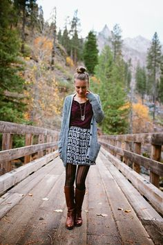 Love the printed skirt with loose, tucked tee and long necklace. Also love the sweater and tight combo.