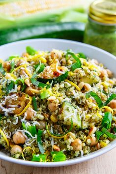 Pesto Zucchini and Corn Quinoa Salad | 1 cup quinoa, rinsed 1 3/4 cups water or broth 1 tablespoon olive oil 2 cloves garlic, chopped 4 cups zucchini (~2 medium sized zucchini), diced 1 cup corn, fresh or frozen salt and pepper to taste 1 (15 ounce) can of chickpeas, rinsed and drained 1/4 cup green onions, sliced 1/4 cup pine nuts, toasted 1/2 cup basil pesto (homemade or store bought) 2 tablespoons lemon juice LAWS