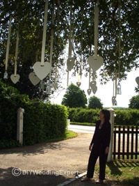 """Hang your musical hearts inside AND outside on the trees to """"brand"""" the decor."""