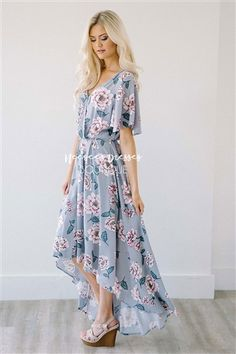 This beautiful high low hemline dress is a breath of fresh air! Light gray dress features a flawless fit, cross over front with clasp closure, elastic waist, lined high low skirt, loose sleeves and a pretty cream and pink floral print.
