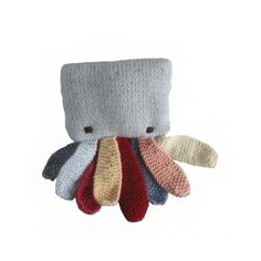 It's a small, hand knitted, Octopus from HandKnitBabyWear.com!