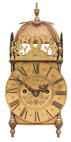 """English lantern clock    Brass, brass dial with blackened roman numerals, irons hands, labelled """"W. Bowyer. 1632"""". Brass movement, strike on full hour on bell. On the sides figurative engravinngs """"Shakespeare"""". With pendulum and key. H. 37,5 cm, w. 17 cm, d. 15 cm."""